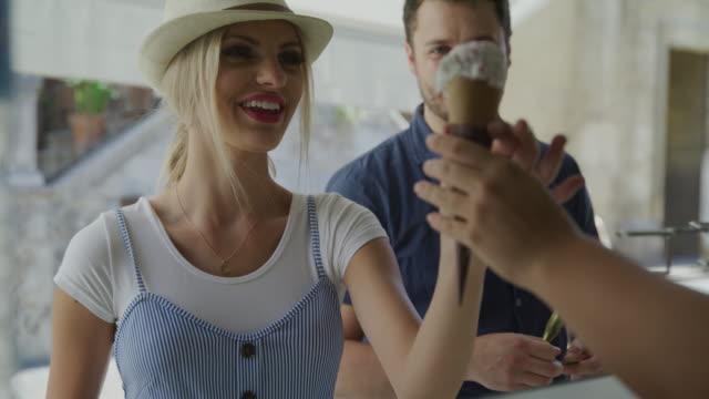 couple buying gelato cone at urban shop / cordoba, cordoba, spain - gelato stock videos & royalty-free footage
