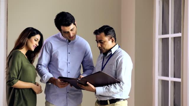 couple buying house, delhi, india - strategia di vendita video stock e b–roll