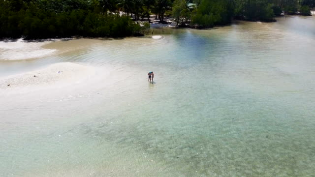 couple by the ocean. tourist on koh rong island dream beach cambodia - gulf of thailand stock videos & royalty-free footage