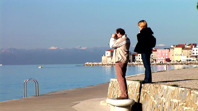 hd: couple by the sea - slovenia stock videos & royalty-free footage
