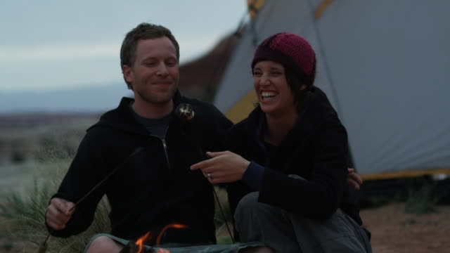 couple camping - marshmallow video stock e b–roll