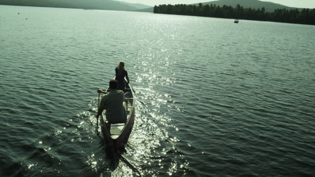 WS HA TU Couple canoeing on Lower Richardson Lake in the western mountains of Maine, South Arm, USA