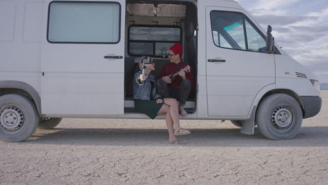 couple capturing their trip on a video camera - van vehicle stock videos and b-roll footage