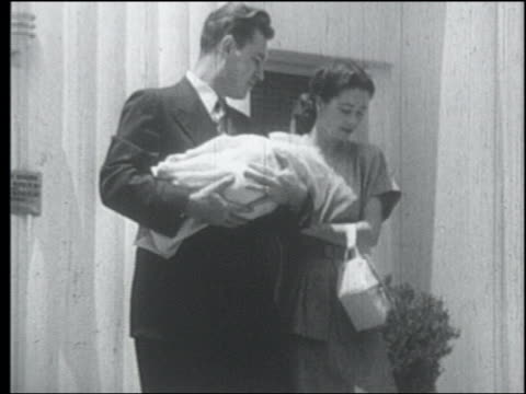b/w 1952 couple carrying newborn down stairs outdoors - 1952 stock videos & royalty-free footage