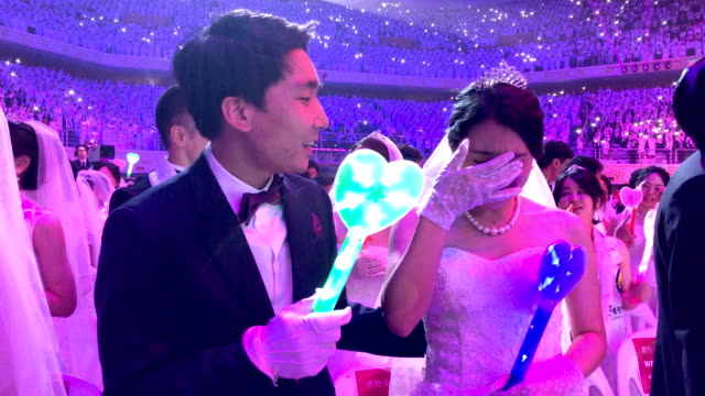 couple celebrate for their wedding ceremony of the family federation for world peace and unification, commonly known as the unification church, at... - south korea couple stock videos & royalty-free footage