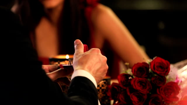 couple celebrating anniversary in restaurant, delhi, india - engagement ring stock videos and b-roll footage