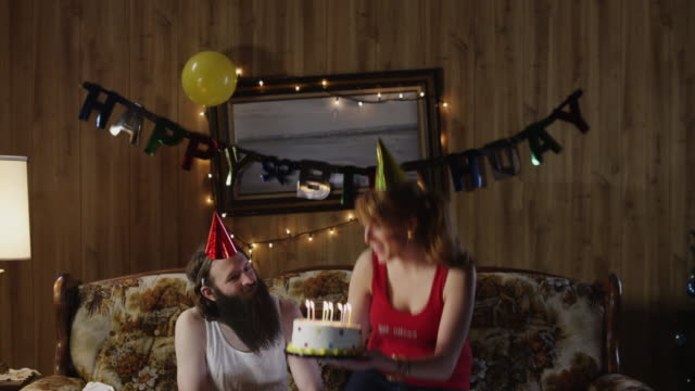 ms td couple celebrating birthday in living room / orem, utah, usa - party hat stock videos and b-roll footage