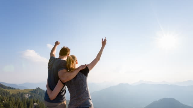 Couple celebrating on mountain top