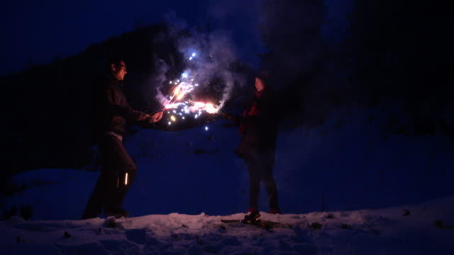 Couple celebrating with fireworks