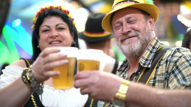 couple celebration toast at oktoberfest in blumenau, santa catarina, brazil - german culture stock videos & royalty-free footage