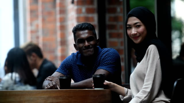 couple chatting at a cafe - malaysian culture stock videos and b-roll footage