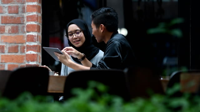 couple chatting at a cafe - hijab stock videos and b-roll footage