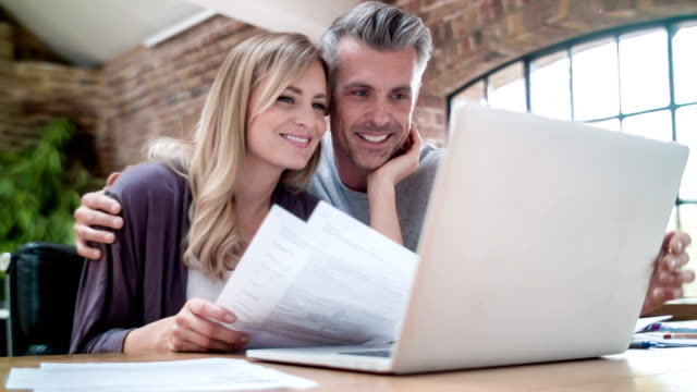 couple checking home finances - home finances stock videos & royalty-free footage