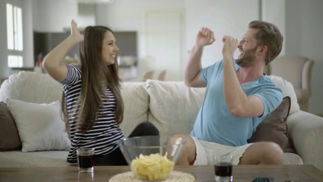 couple cheering about success