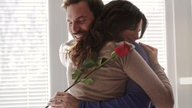 couple cherish every single second of their long hug - single rose stock videos & royalty-free footage
