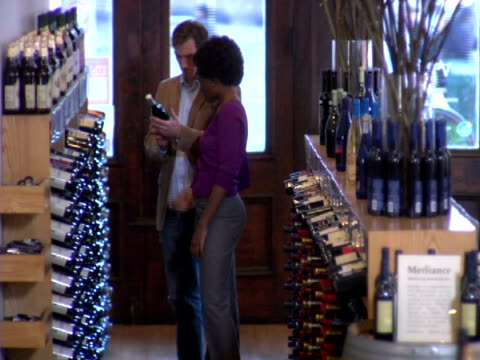 ms, couple choosing wine in liquor store, soho, new york city, new york, usa - liquor store stock videos and b-roll footage