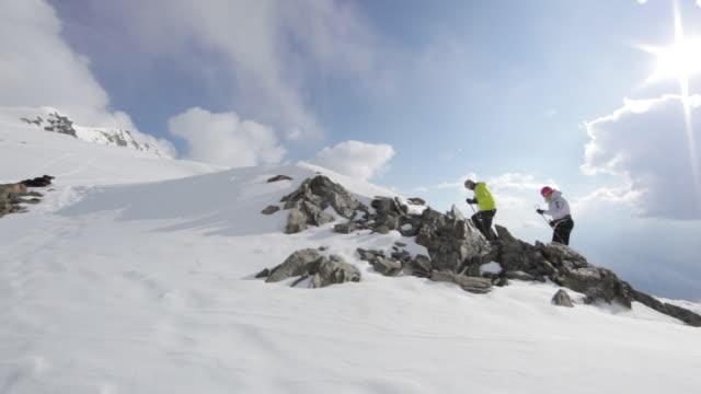 WS PAN Couple climbing on snow and ice covered mountain in  Austrian Alps / Stubai Glacier, Tirol, Austria