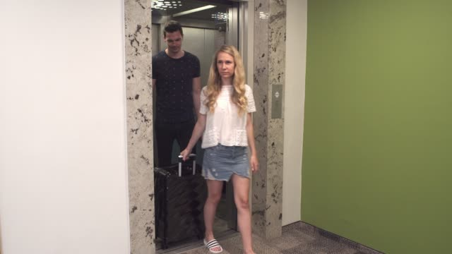 Couple coming out of the elevator in a hotel