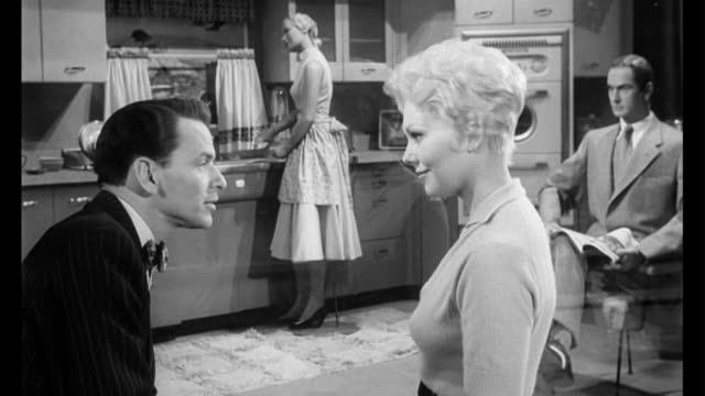 1955 couple (kim novak & frank sinatra) construct a narrative for the mannequins in a store window display kitchen - frank sinatra stock videos & royalty-free footage