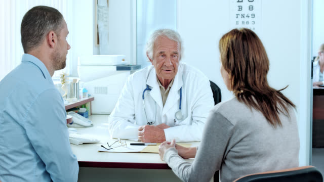 Couple consulting the attending physician