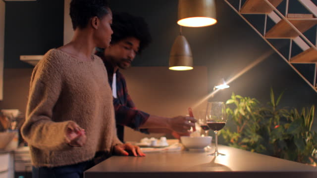 couple cooking and sharing some time together. - young couple stock videos & royalty-free footage