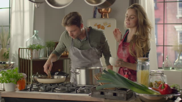 couple cooking together in kitchen - cooking stock videos & royalty-free footage