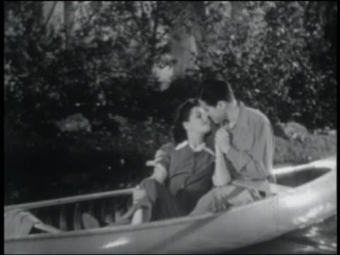 B/W 1941 couple cuddling in canoe