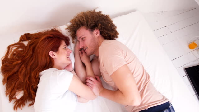 couple cuddling in the bed - 25 29 ans stock videos & royalty-free footage