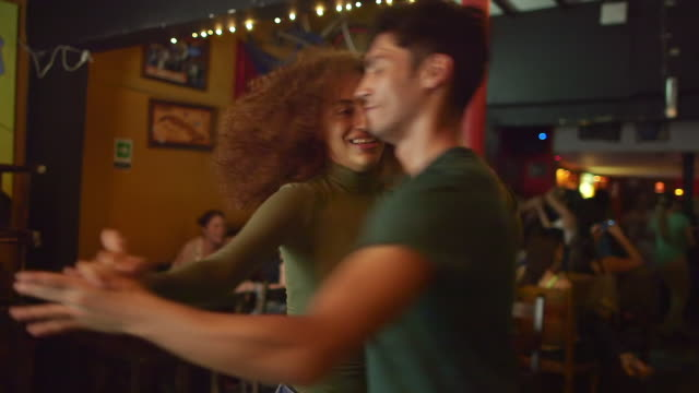 a couple dance together in a salsa club - bronek kaminski stock videos & royalty-free footage