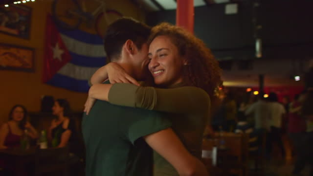 a couple dance together in a salsa club - party social event stock videos & royalty-free footage