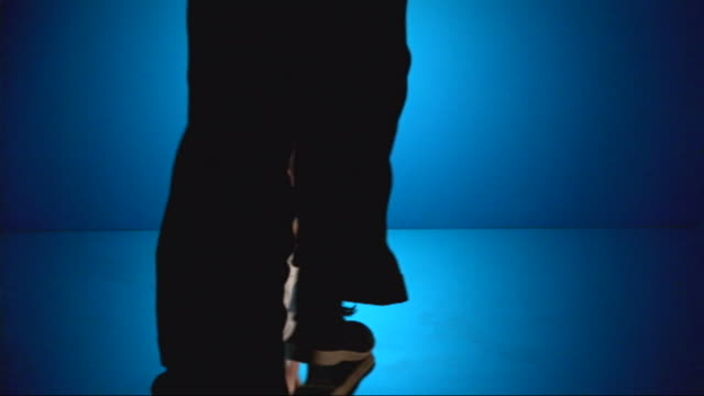 a couple dances under a blue light. - under her feet stock videos & royalty-free footage