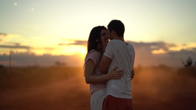 couple dancing at country road on sunset time - adventure stock videos & royalty-free footage
