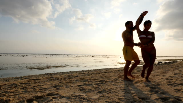 couple dancing bachata at the beach in bali - latin american culture stock videos & royalty-free footage