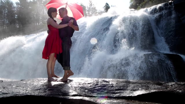 couple dancing by waterfall - red dress stock videos & royalty-free footage