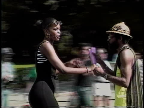 couple dancing in roller skates in nyc park - 1990 stock videos & royalty-free footage
