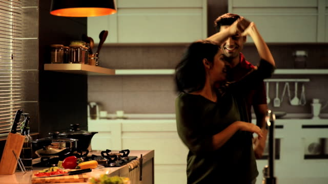 couple dancing in the kitchen, delhi, india - indian ethnicity stock videos & royalty-free footage