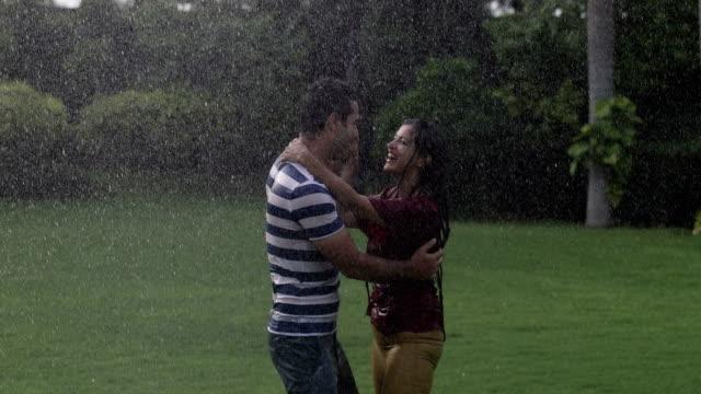 Couple dancing in the rain season, Delhi, India