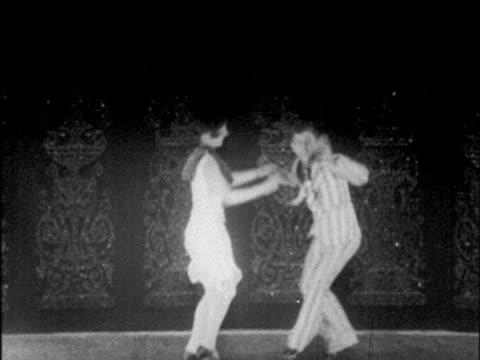 b/w 1925 couple dancing lindy hop on stage / doing backflips / chicago / newsreel - 1920 stock-videos und b-roll-filmmaterial