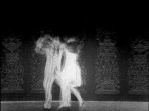 b/w 1925 couple dancing lindy hop on stage / doing spins / chicago / newsreel - 1925 stock videos & royalty-free footage