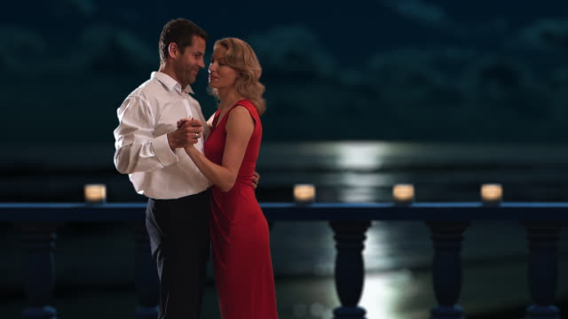 vidéos et rushes de couple dancing on a balcony at night/marbella region, spain - slow