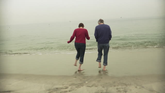 WS Couple dancing on beach / Sea Bright, New Jersey, USA
