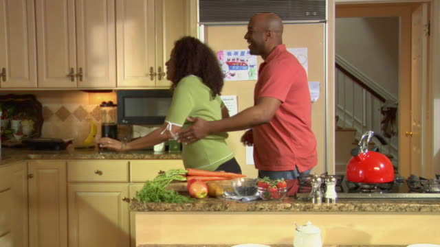 MS ZI Couple dancing together in their kitchen / White Plains, New York, USA