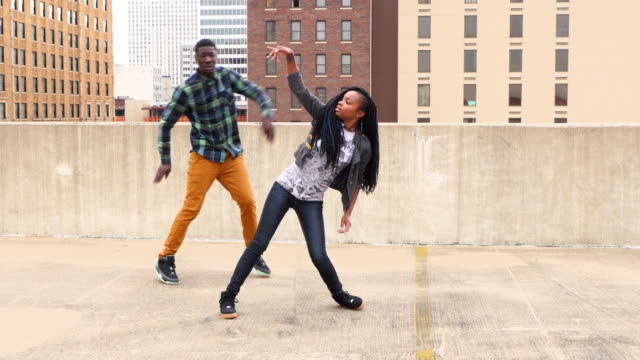 ms couple dancing together on rooftop - jeans stock videos & royalty-free footage