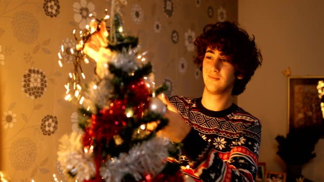 couple decorating christmas tree.christmas time is even more fun with you - fairy lights stock videos & royalty-free footage