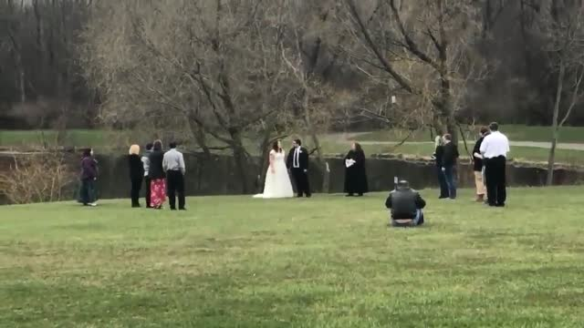 couple didn't let the coronavirus pandemic stand in their way when they tied the knot in a socially distant ceremony at a park in chili, new york, on... - wedding vows stock videos & royalty-free footage