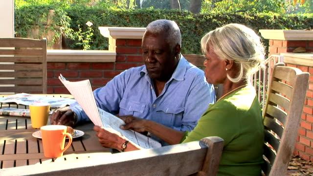 stockvideo's en b-roll-footage met couple dining on terrace - publicatie