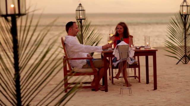 couple dining on tropical beach