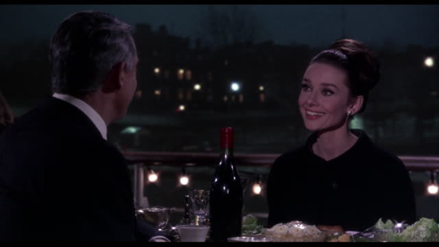1963 Couple (Cary Grant and Audrey Hepburn) discuss missing money and relationship as they dine on a barge