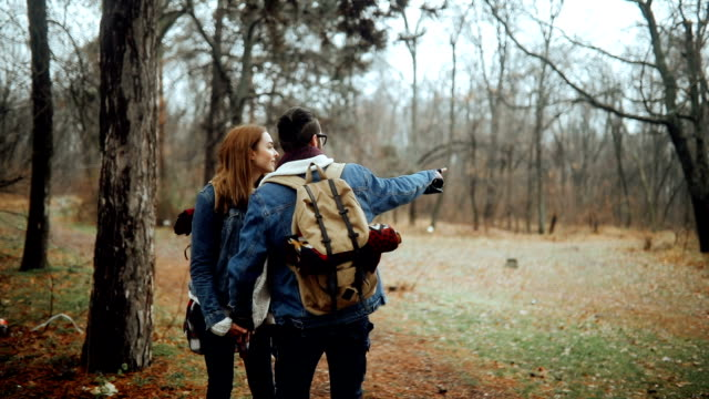 Couple discussing which way to go next while hiking in nature