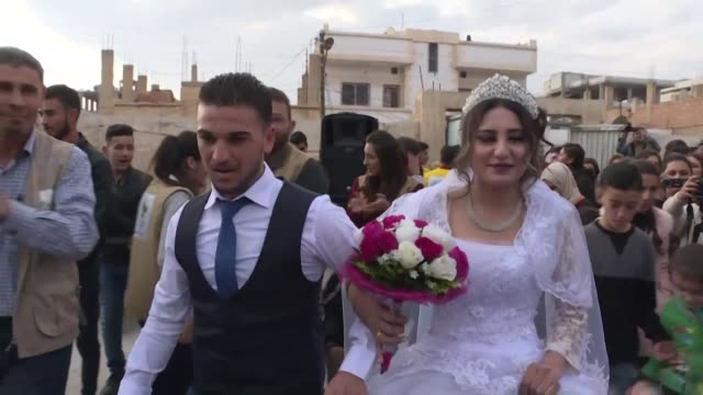 a couple displaced by turkey's offensive on the northeastern syrian border town of ras al ain get married in a school in hasakeh where they have... - married stock videos & royalty-free footage